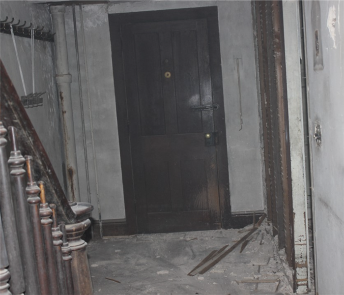 Door and hallway with severe fire damage.